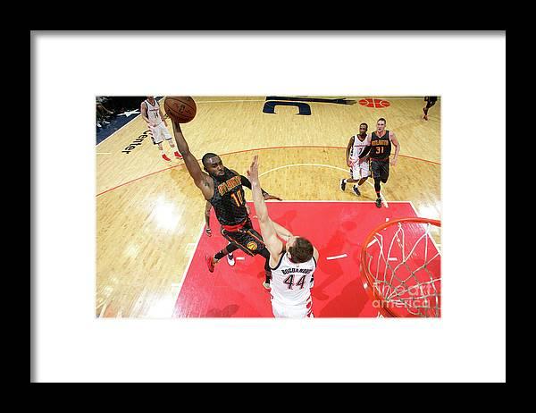 Tim Hardaway Jr. Framed Print featuring the photograph Atlanta Hawks V Washington Wizards - by Ned Dishman