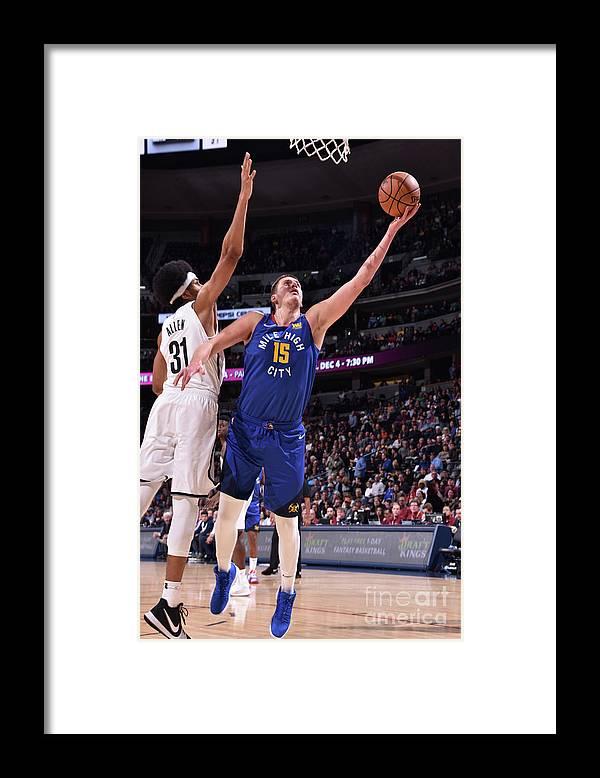 Nba Pro Basketball Framed Print featuring the photograph Brooklyn Nets V Denver Nuggets by Garrett Ellwood