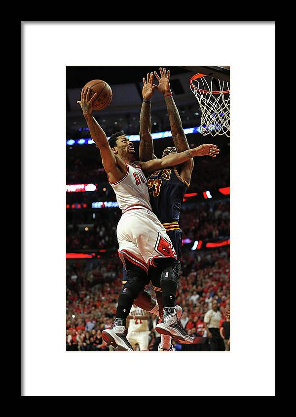 Chicago Bulls Framed Print featuring the photograph Cleveland Cavaliers V Chicago Bulls - by Jonathan Daniel