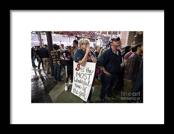 Facial Expression Framed Print featuring the photograph Cleveland Indians Fans Gather To The by Justin Merriman
