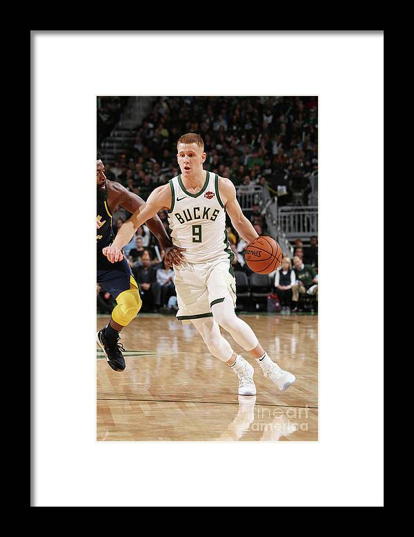Nba Pro Basketball Framed Print featuring the photograph Indiana Pacers V Milwaukee Bucks by Gary Dineen