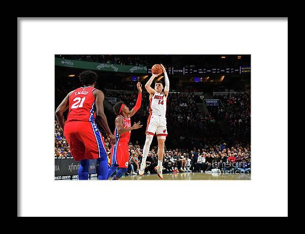 Tyler Herro Framed Print featuring the photograph Miami Heat V Philadelphia 76ers by Jesse D. Garrabrant