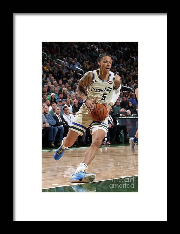 Nba Pro Basketball Framed Print featuring the photograph New York Knicks V Milwaukee Bucks by Gary Dineen