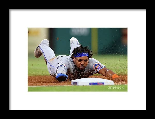 Baseball Catcher Framed Print featuring the photograph New York Mets V Philadelphia Phillies by Rich Schultz