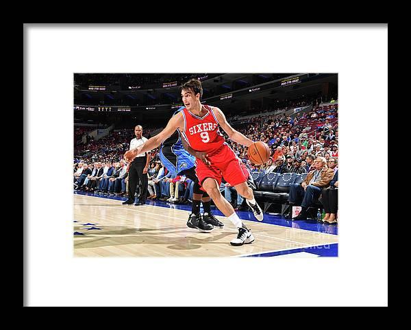 Nba Pro Basketball Framed Print featuring the photograph Philadelphia 76ers V Orlando Magic by Jesse D. Garrabrant
