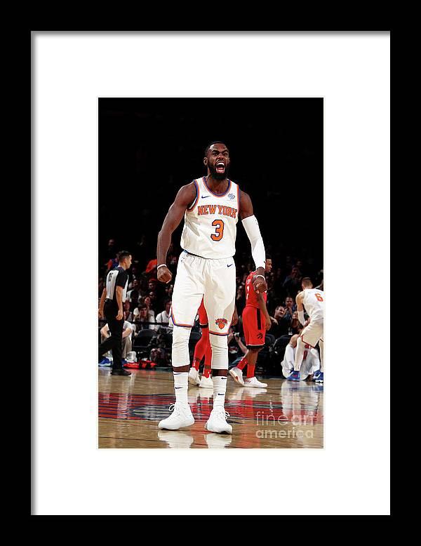 Tim Hardaway Jr. Framed Print featuring the photograph Toronto Raptors V New York Knicks by Nathaniel S. Butler