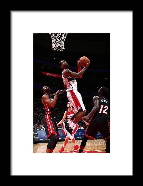 Nba Pro Basketball Framed Print featuring the photograph Miami Heat V Washington Wizards by Ned Dishman