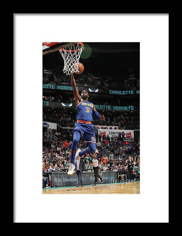 Tim Hardaway Jr. Framed Print featuring the photograph New York Knicks V Charlotte Hornets by Kent Smith