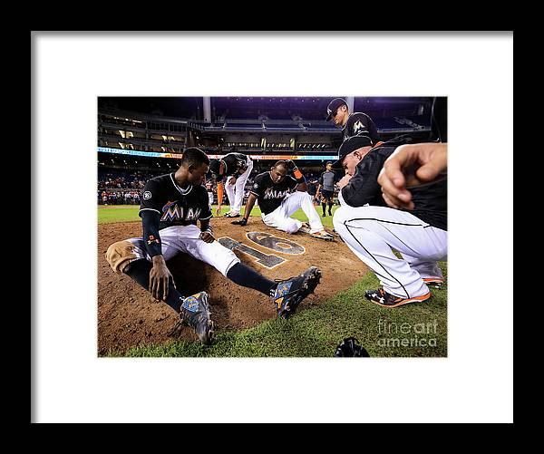 People Framed Print featuring the photograph New York Mets V Miami Marlins by Rob Foldy