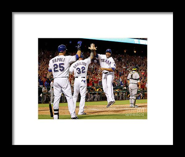 American League Baseball Framed Print featuring the photograph Oakland Athletics V Texas Rangers by Rick Yeatts