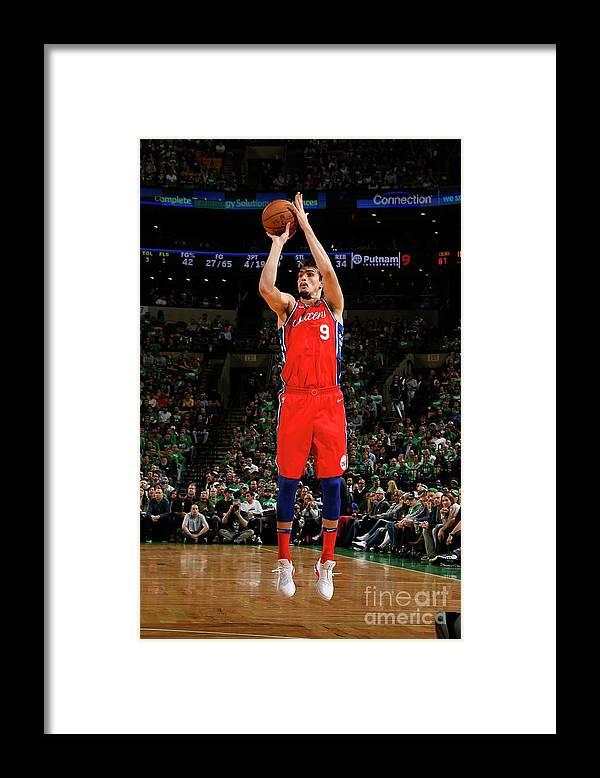 Playoffs Framed Print featuring the photograph Philadelphia 76ers V Boston Celtics - by Brian Babineau