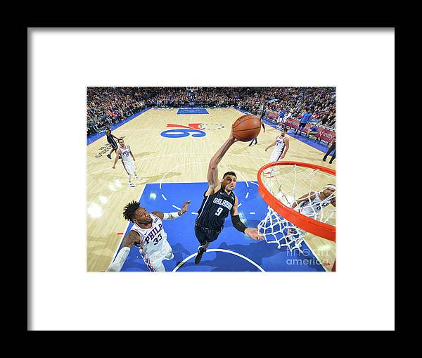 Nba Pro Basketball Framed Print featuring the photograph Philadelphia 76ers V Orlando Magic by Jesse D. Garrabrant