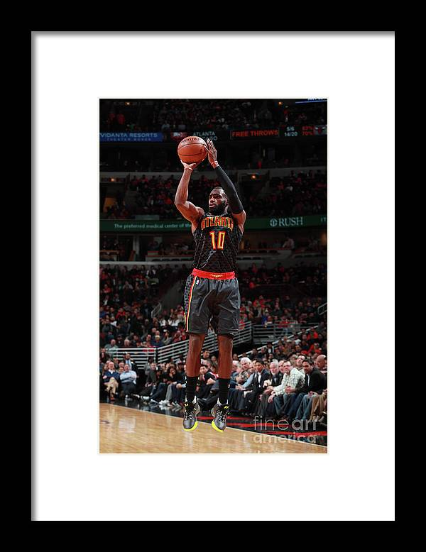Tim Hardaway Jr. Framed Print featuring the photograph Atlanta Hawks V Chicago Bulls by Jeff Haynes