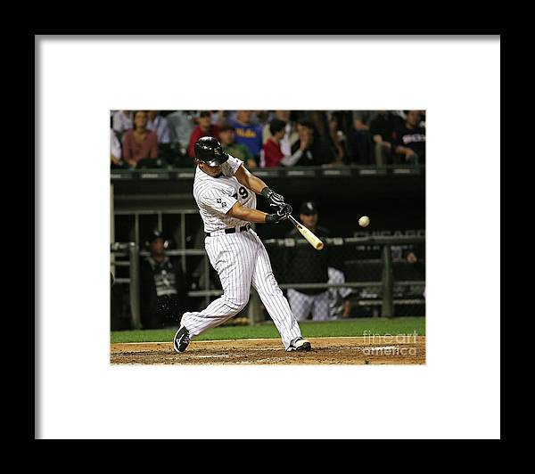 People Framed Print featuring the photograph Cleveland Indians V Chicago White Sox by Jonathan Daniel