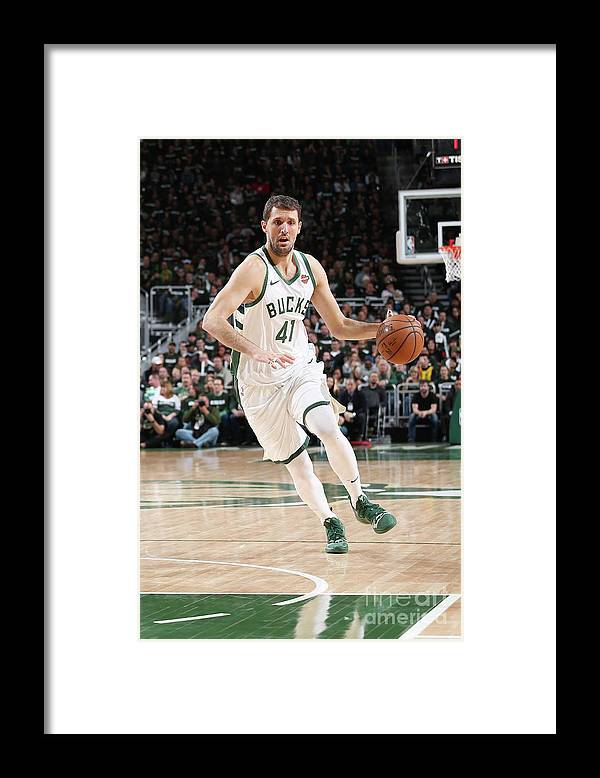 Playoffs Framed Print featuring the photograph Detroit Pistons V Milwaukee Bucks - by Gary Dineen