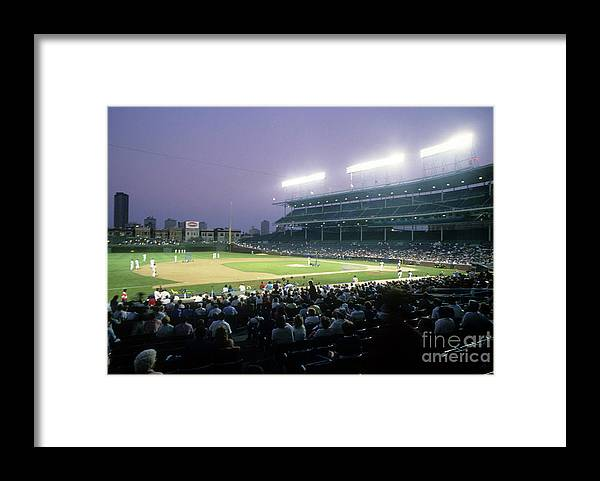 1980-1989 Framed Print featuring the photograph Philadelphia Phillies V Chicago Cubs by Jonathan Daniel