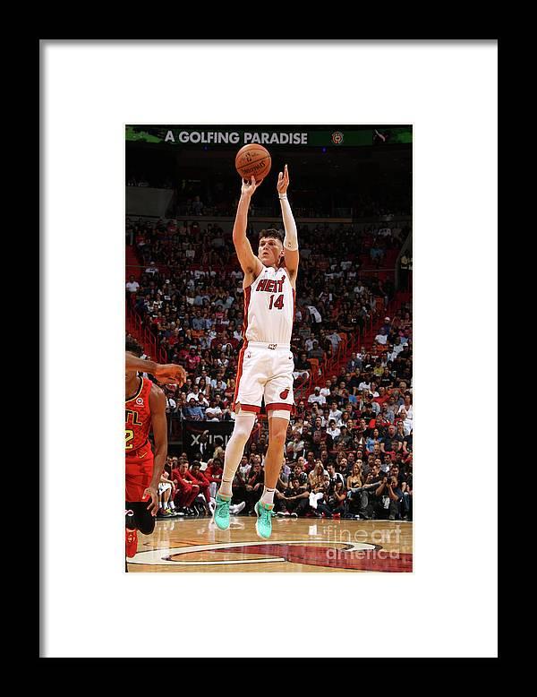 Tyler Herro Framed Print featuring the photograph Atlanta Hawks V Miami Heat by Oscar Baldizon