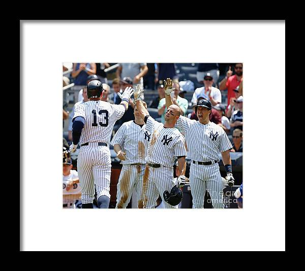 Three Quarter Length Framed Print featuring the photograph Kansas City Royals V New York Yankees by Al Bello