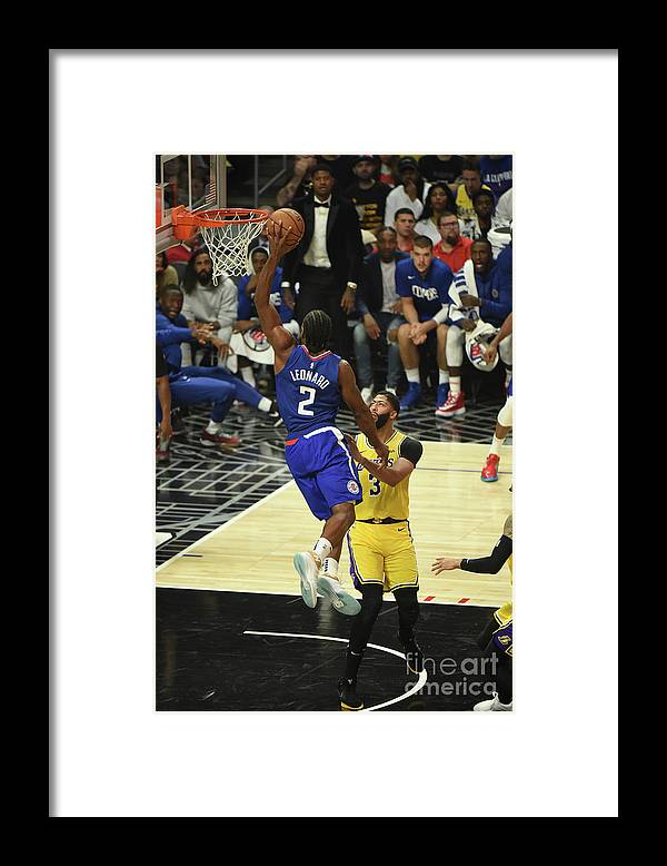 Framed Print featuring the photograph Los Angeles Lakers V La Clippers by Adam Pantozzi