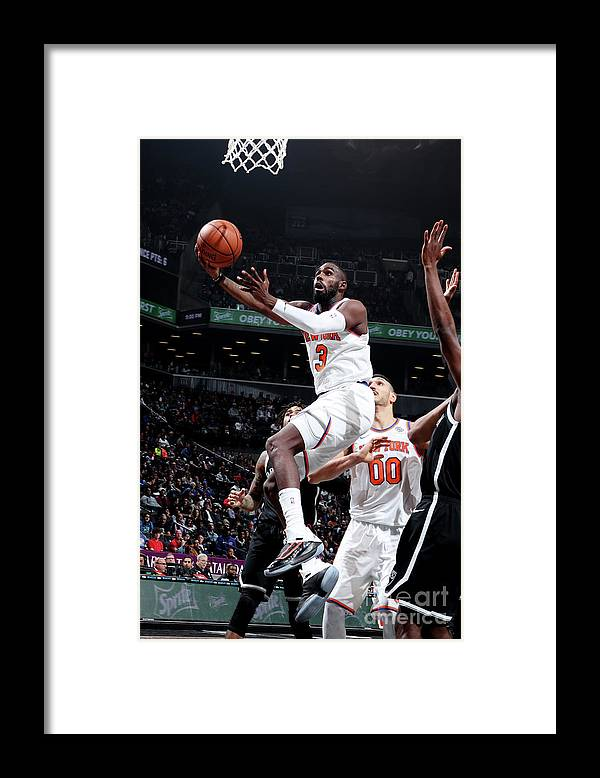Tim Hardaway Jr. Framed Print featuring the photograph New York Knicks V Brooklyn Nets by Nathaniel S. Butler
