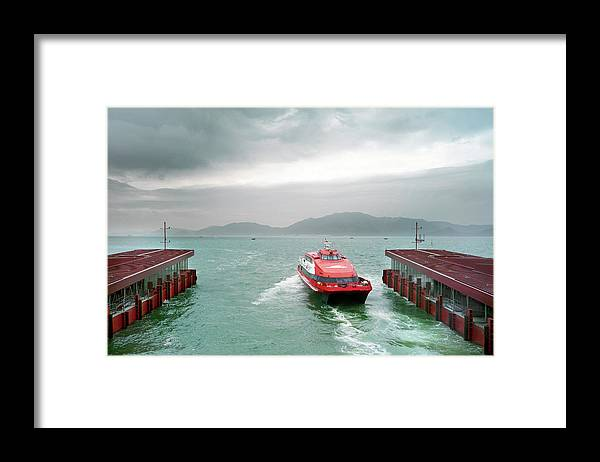 Macao Framed Print featuring the photograph A Catamaran Ferry Docks At A Port by Xpacifica