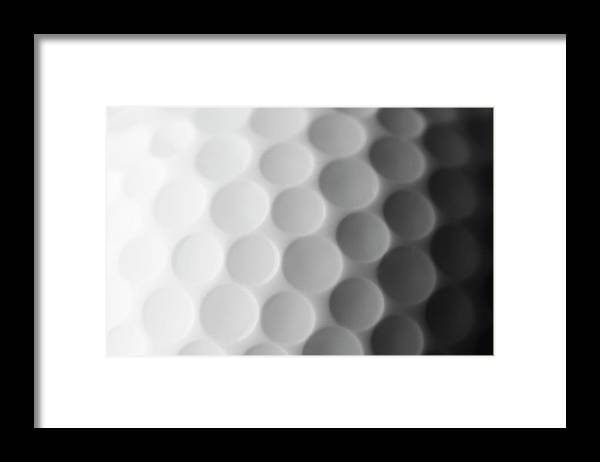 Ball Framed Print featuring the photograph A Close Up Shot Of A Golf Ball, White by Anthiacumming