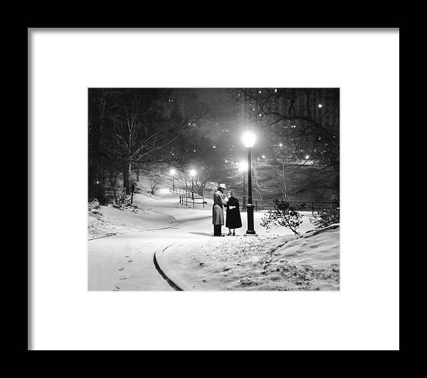 1950-1959 Framed Print featuring the photograph A Couple Pauses For A Cigarette In by New York Daily News Archive