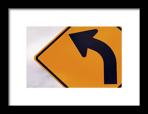 Curve Framed Print featuring the photograph A Curve Ahead Road Sign Warning by Martin Ruegner