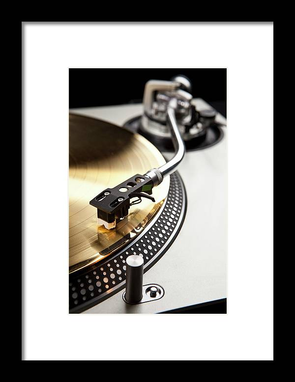 Music Framed Print featuring the photograph A Gold Record On A Turntable by Caspar Benson