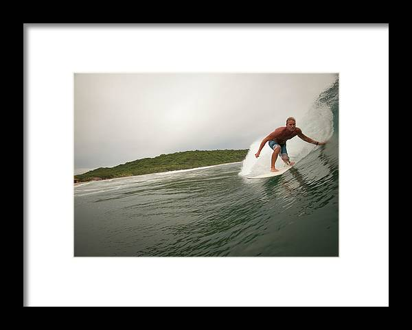Focus Framed Print featuring the photograph A Male Surfer In A Barrel Of A Wave In by Sean Murphy