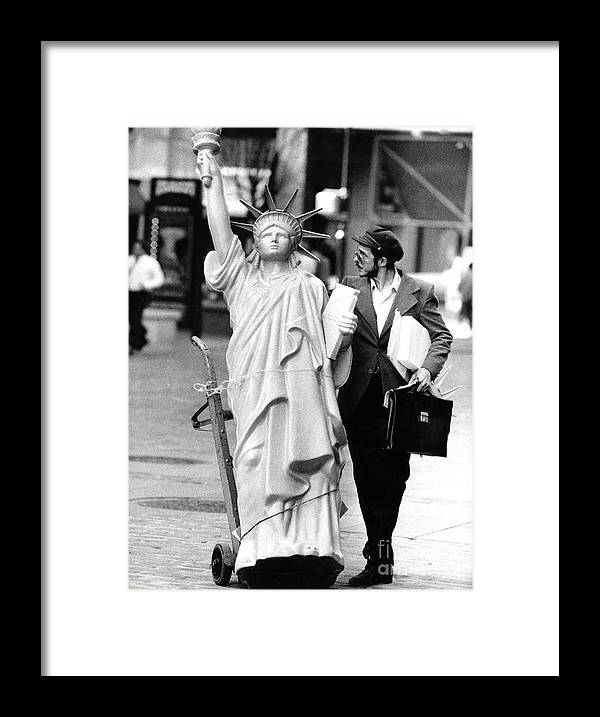 1980-1989 Framed Print featuring the photograph A Model Of Lady Liberty Was Being Sold by New York Daily News Archive