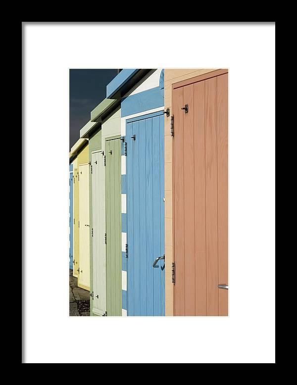 Beach Hut Framed Print featuring the photograph A Row Of Beach Huts by Matthew Piper