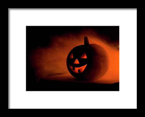 Horror Framed Print featuring the photograph A Scary Halloween Pumpkin In Smoke by Ilonabudzbon