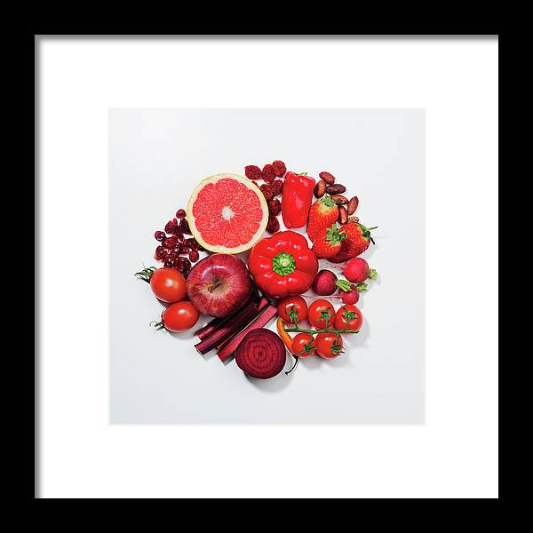 White Background Framed Print featuring the photograph A Selection Of Red Fruits & Vegetables by David Malan