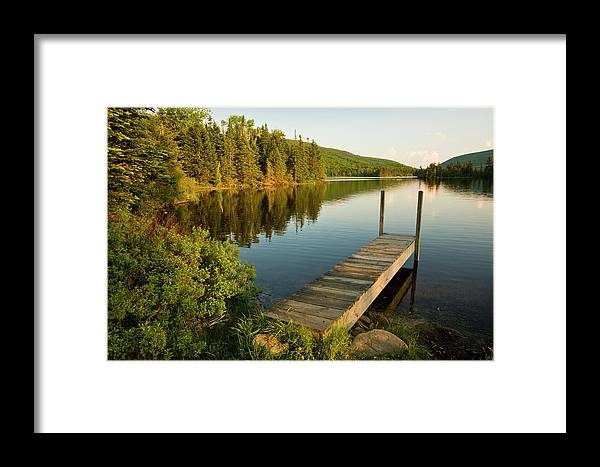 Tranquility Framed Print featuring the photograph A Small Dock In Long Pond In White by Danita Delimont