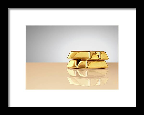 Four Objects Framed Print featuring the photograph A Stack Of Four Gold Ingots by Anthony Bradshaw