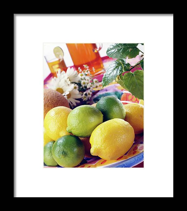 Close-up Framed Print featuring the photograph A Summer Table Setting With Lemons And by Steve Wisbauer