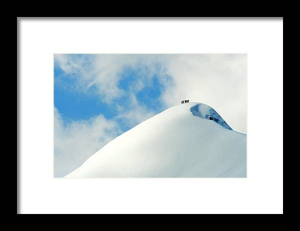The End Framed Print featuring the photograph A Team Of People Climbing A Snowy by Lopurice