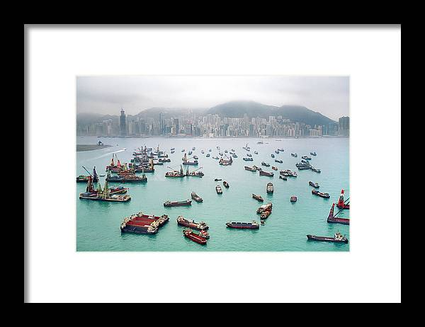 Trading Framed Print featuring the photograph A View Of Hong Kong Harbor Through A by Xpacifica