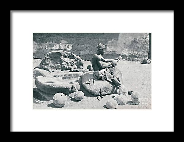Working Framed Print featuring the drawing A Yoruba Man Engraving Clay Bowls by Print Collector