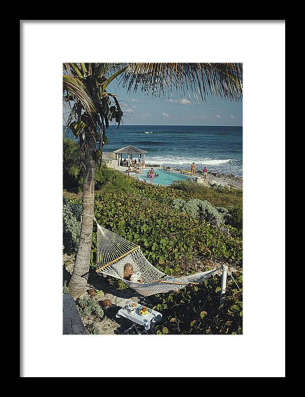 1980-1989 Framed Print featuring the photograph Abaco Holiday by Slim Aarons