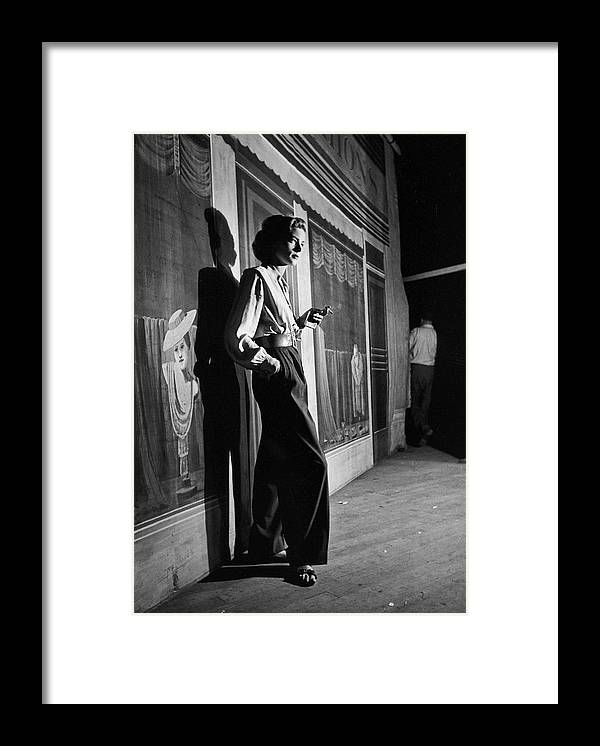 Young Men Framed Print featuring the photograph Actress Lauren Bacall Smoking A by Alfred Eisenstaedt