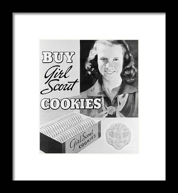 Child Framed Print featuring the photograph Advertisement Poster For Girl Scout by Bettmann