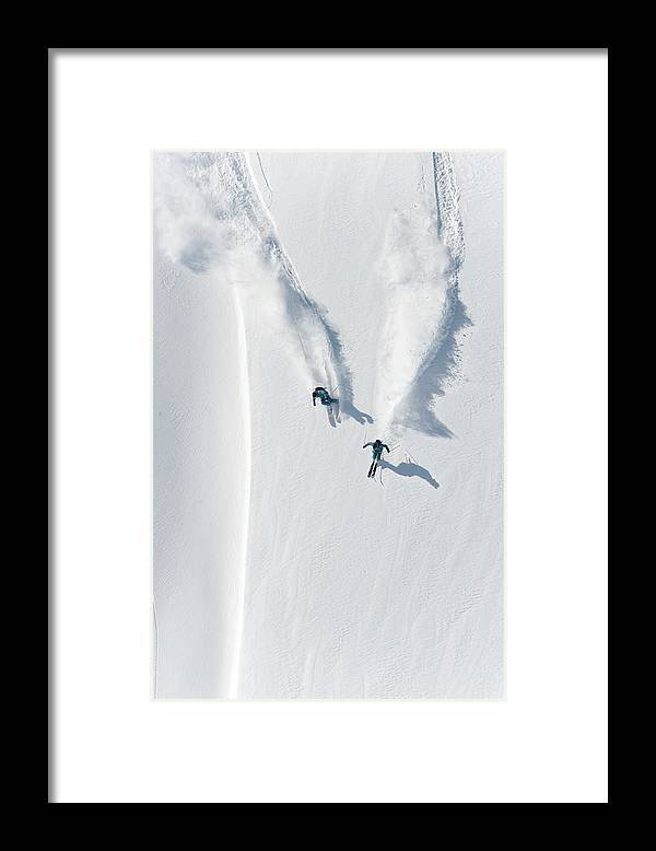 Crash Helmet Framed Print featuring the photograph Aerial View Of Two Skiers Skiing by Creativaimage