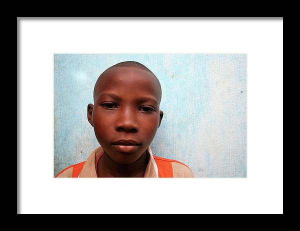 Education Framed Print featuring the photograph African Boy by Peeterv