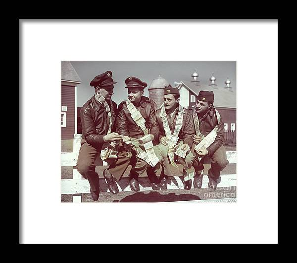 Young Men Framed Print featuring the photograph Air Force Gunners Comparing Short by Bettmann