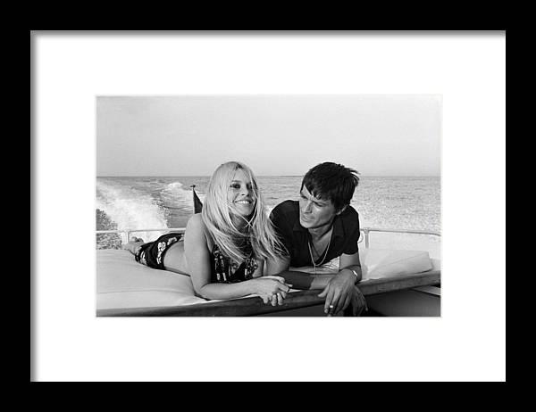 Alain Delon Framed Print featuring the photograph Alain Delon And Brigitte Bardot In by Jean-pierre Bonnotte