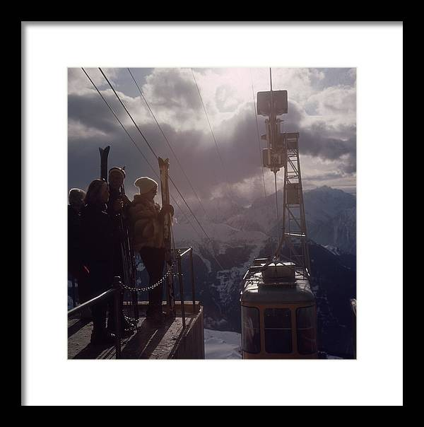 Skiing Framed Print featuring the photograph Alpine Skiing by Slim Aarons