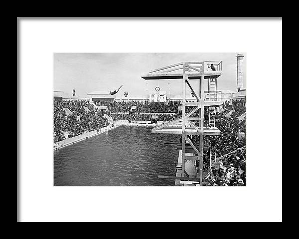 Diving Into Water Framed Print featuring the photograph American Diver Winning Gold Medal by Bettmann
