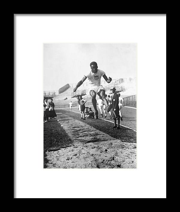 The Olympic Games Framed Print featuring the photograph American Hubbard Wins Olympic Long Jump by Bettmann